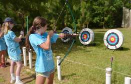The Royal Republic and Autonomous  Sovereign and Voting state of Louisiana -  Girl Scouts Louisiana East -- Girl Scouts practice archery during the Camp